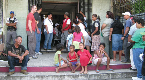 People wait to be seen at a clinic site.
